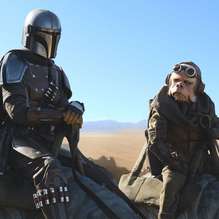 The Mandalorian and the hermit ride blurrgs in the desert